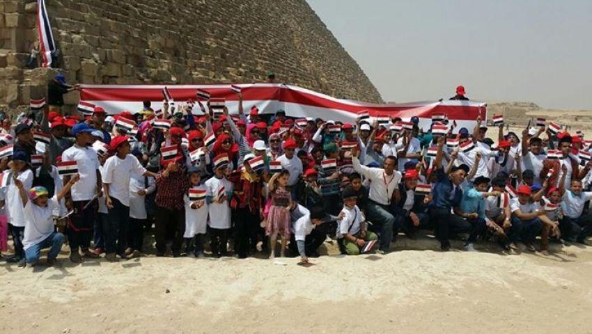 500 طفل يتيم بين أحضان الأهرامات