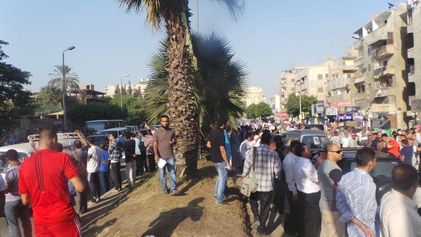 سلسلة بشرية بشارع الهرم تنديدًا بمجزرة رابعة والنهضة