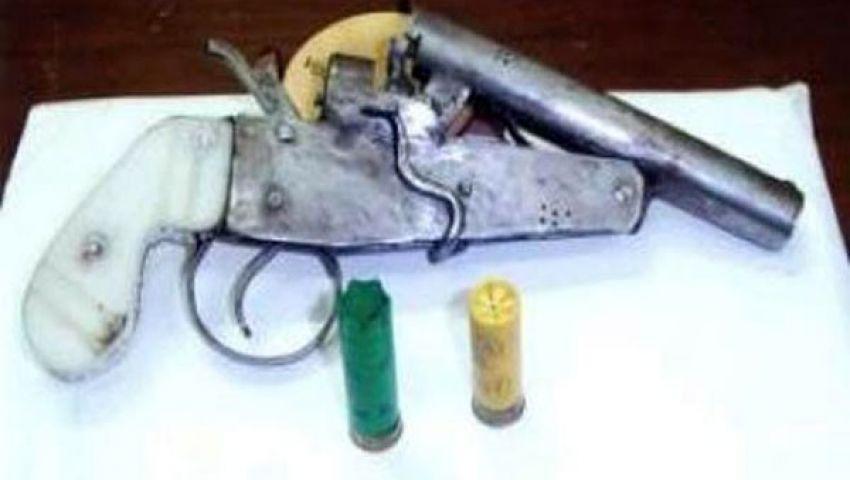ضبط سلاح ناري مع منجد بدمياط
