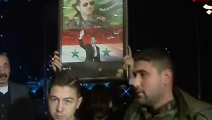 بالفيديو..أنصار بشار يحتفلون بسقوط حلب