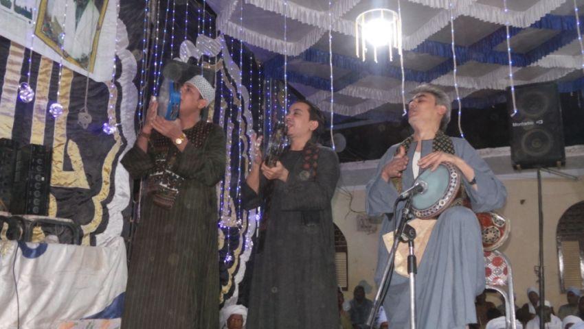 صور| «إنشاد وولائم».. احتفالات المولد النبوي الشريف بالصعيد