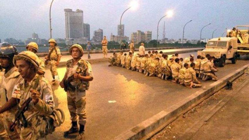 الجيش يغلق كوبري الجامعة لمنع مسيرة لأنصار مرسي