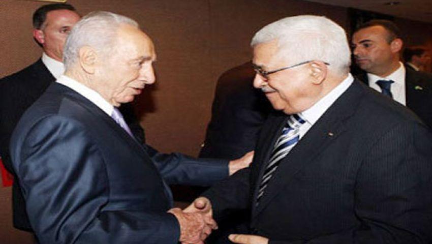 بيريز يهنئ عباس على قرار استئناف محادثات السلام