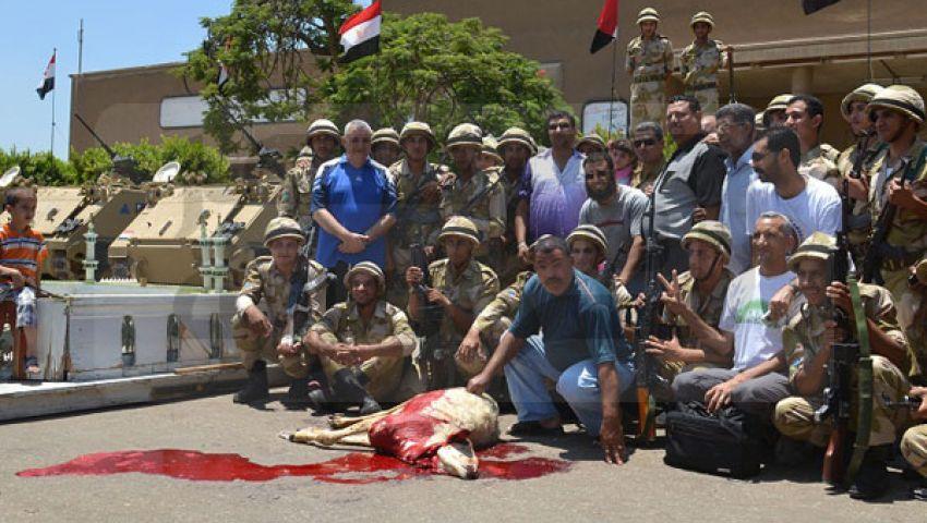 الجيش يذبح خروفا في المحلة احتفالا بـ 30 يونيو