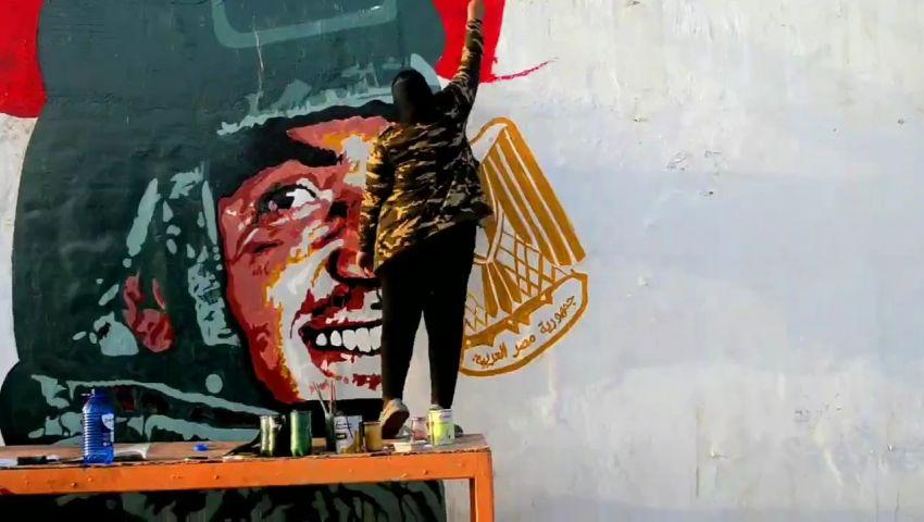 على جدار فنار المكس.. فنانة سكندريةترسم جرافيتي للشهيد منسي (صور)