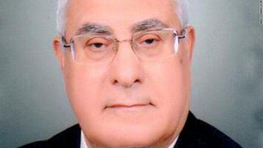 منصور يعود من الكويت