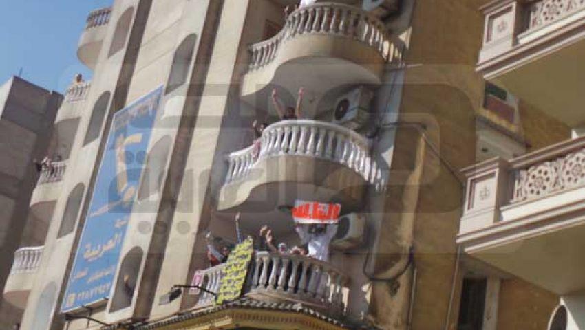 بالصور.. عمارة كاملة في مدينة نصر تؤيد مرسي