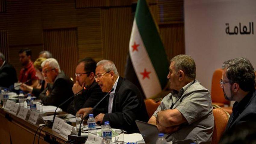 المعارضة السورية: متمسكون بتنحي الأسد